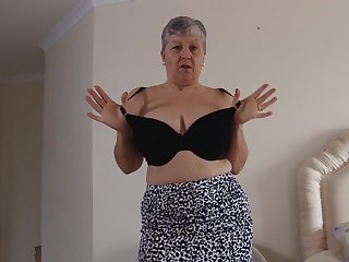 Short haired mature amateur British granny Savana strips handy home