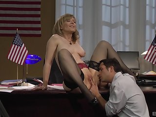 Mature flaxen-haired Nina Hartley bent over the desk and fucked far stockings