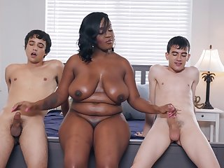 Chubby chesty ebony MILF Layton Benton takes a handful of big white dicks